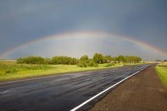 Road to the rainbow. Stock Photo