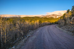 Road 116 to rainbow lakes campground  with Kiowa Peak in the Bac Royalty Free Stock Image