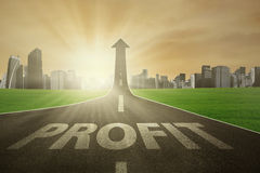 The road to raise profit. Road with Profit word, turning into arrow upward symbolizing the path to increase profit Stock Photography