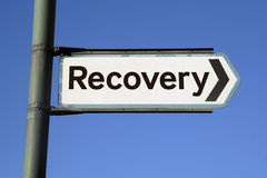 Road to recovery. Conceptional sign pointing towards better times - economic recovery ahead Royalty Free Stock Photos