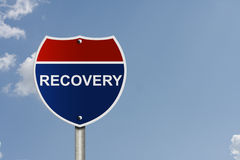 The road to recovery. An American interstate road sign with sky background and copy space for your message, The road to recovery royalty free stock images