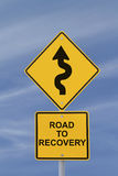 Road to Recovery. Conceptual road sign indicating a long and winding road to recovery Stock Photos