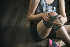 On the road to recovery for knee injury, fitness exercise Royalty Free Stock Images