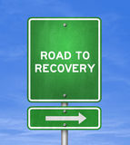 Road to recovery. Road sign Stock Images