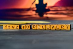 Road to recovery on wooden blocks. Cross processed image with bokeh background stock photography