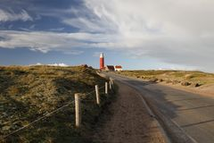 Road to red lighthouse on Texel stock photo