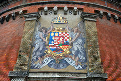 Road to Royal Palace with ancient mosaic Coat of Arms on Castle Stock Photos
