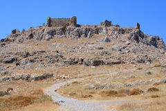 Road to ruined castle. Road to the remains of ancient castle on cape Falakros. Rhodes, Greece Stock Photo