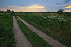 The road to the Russian heartland. A dirt road during the sunset. Central Russia Royalty Free Stock Image