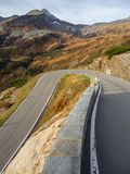Road to the San Bernardino mountain pass in Switzerland.  View of the mountain bends creating beautiful shapes. Road to the San Bernardino mountain pass in stock photos