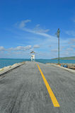 Road to sea. On blue sky Royalty Free Stock Photography