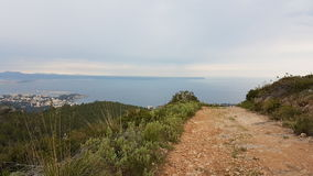 Road to the sea. In cloudy day in Balearic islands Stock Image