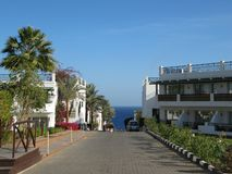The road to the sea in the hotel with a beautiful view on a bright day royalty free stock images