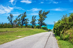 Road to the Sea. A lonely road leading to Tobacco Bay in scenic Bermuda Stock Image