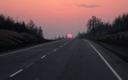 Road to Siberia in winter sunset. Royalty Free Stock Photo