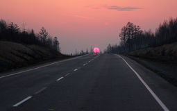 Road to Siberia in winter sunset Stock Images