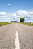 Road to sky. Countryside road and a blue sky Royalty Free Stock Images