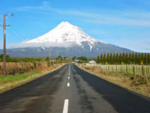 Road to a snow capped mount egmont Royalty Free Stock Photography