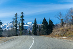 Road to snowy heights in mountains Stock Photography
