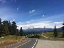 Road to the snowy mountains Royalty Free Stock Image