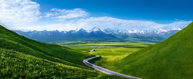 Road to snowy mountains royalty free stock photography