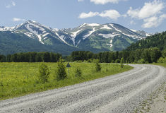 The road to snowy mountains Royalty Free Stock Photography