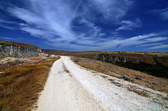 The Road To Somewhere. White stony road somewhere in Sumba island, Indonesia stock image