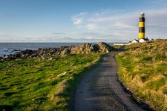 The road to St John`s Point Light house stock images