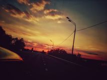 The road to St. Petersburg, sunset. The journey on the evening road stock photography