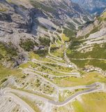 Road to the Stelvio mountain pass in Italy. Amazing aerial view of the mountain bends creating beautiful shapes. Summer time stock photos