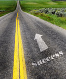 Road to Success. With painted double yellow lines Stock Image