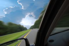 Road to Success. A car driving fast into the opening of a cloud Stock Photo
