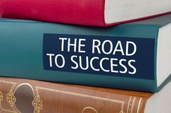 The Road to success. A book with the title The Road to success Royalty Free Stock Images