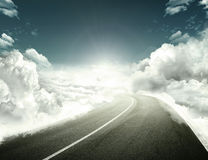 Road to success. Road in a cloud means success and hope Stock Photos