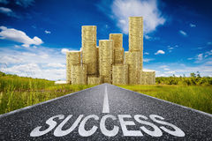 Road to success concept. With 3d rendered success text on asphalt road and stack of gold coins Stock Photography