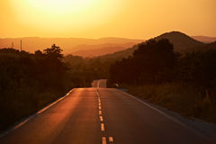 Road to the summer sunset Royalty Free Stock Photos