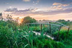 Road to the Sun. Dawn. In the foreground a shiny metal bridge after the rain royalty free stock photography