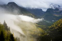 Road to the Sun Overlook. Valley shrouded with cloud in the fall splendor at Glacier National Park, Montana Stock Photography