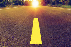Road to the sun. Straight road to sunrise/sunset, successful concept, vintage tone Royalty Free Stock Photos