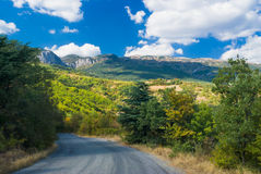 Road to sunny mountains Stock Photography