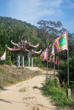 Road to Taku mountain with buddhist flags and arch Royalty Free Stock Images