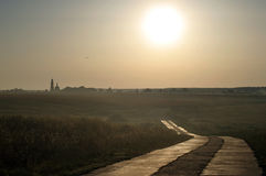 Road to temple. Road to old temple in Russian province. Golden Ring region Stock Photo