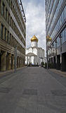 The road to the temple. Old Believers' Church and the new office buildings near the Byelorussian railway station in Moscow, Russia Stock Photos