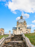 The road to the temple. Catholic church of the Holy Trinity. Liskiava Stock Photos