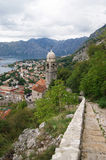 The road to the temple. View of the Church of Our Lady of common over the town of Kotor (Montenegro Royalty Free Stock Image