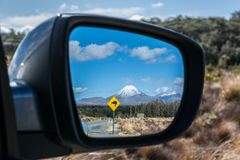 Road to Tongariro National Park with Kiwi sign reflected in the Stock Photo