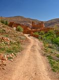 Road to traditional Kasbah, Morocco. Kasbah fortified palace and ksar village fortified by high mudbrick walls in the Valley of the Dades river, Morocco Royalty Free Stock Photo