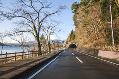 Road to tunnel at Japan with Mt Fuji view and lake Stock Photography