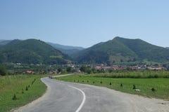 Road to Turnu Rosu mountain village in Transylvania, Romania Royalty Free Stock Images