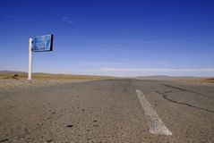 The road to Ulaanbaatar, Mongolia. Remote signpost alongside the main highway from the west to Ulaanbaatar in Mongolia Royalty Free Stock Photography